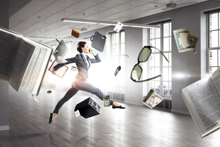 Dancing businesswoman in office. Mixed media