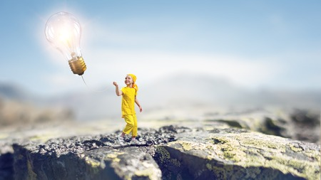 Child playing cheerfully. Mixed media Фото со стока