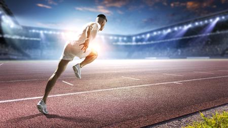 Sportsman running track. Mixed media Stok Fotoğraf