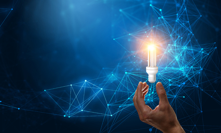Business hand holding glowing light bulb against. 3d rendering