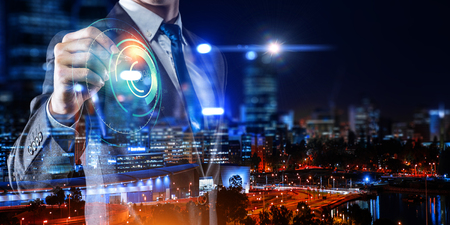 Close of businessman working with media interface on screen. Mixed media Reklamní fotografie
