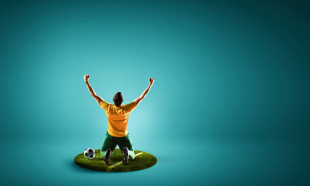 One soccer player man on pedestal against color background. Mixed media