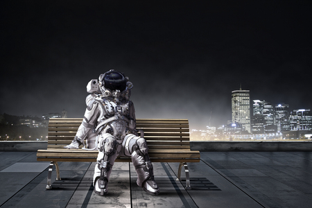 Spaceman sitting on wooden bench. Mixed media