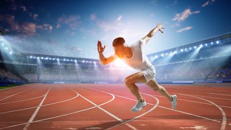 Sportsman running track. Mixed media 스톡 콘텐츠