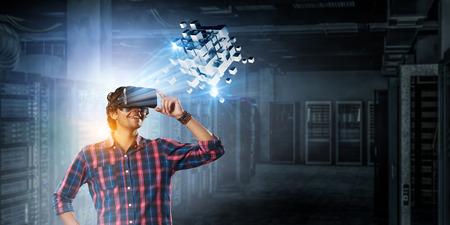 Experiencing virtual technology world. Mixed media Banco de Imagens - 122830397