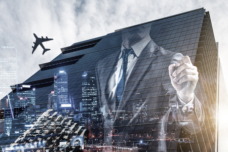 Double exposure of businessman drawing on screen and modern city