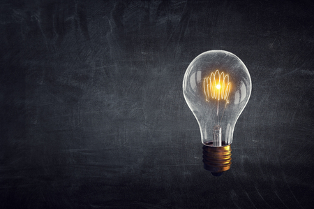 Glowing light bulb as symbol for success idea Stock Photo