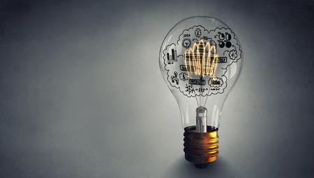 Glowing light bulb as symbol for success idea Фото со стока