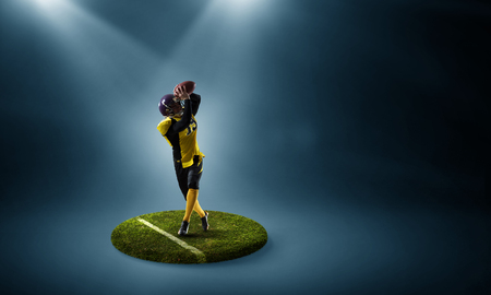 Rugby player on pedestal. Mixed media
