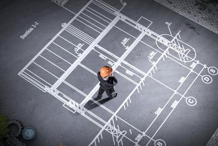 Man engineer thinking over his plan. Mixed media Stock Photo