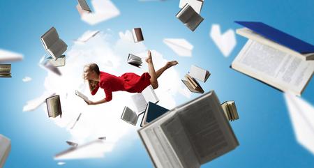 When reading takes your away. Mixed media Stock Photo
