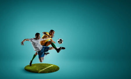 Soccer players on round pedestal. Mixed media