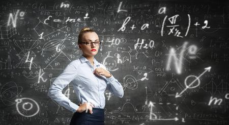Woman teacher in glasses