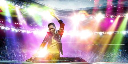 Female dj in nightclub. Mixed media 스톡 콘텐츠