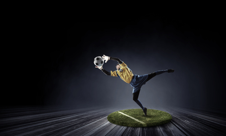Soccer player on round pedestal. Mixed media