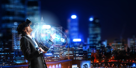 Businessman having VR experience. Mixed media