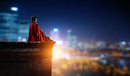 Super hero on roof. Mixed media Stock Photo