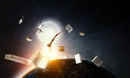Office objects flying in space Stock Photo