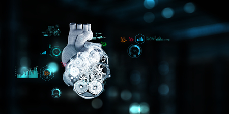 Anatomic heart model made with gears and mechanic parts, digital board background