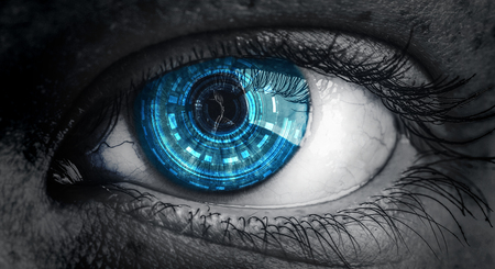 close up of eye with blue digital iris with photographer reflected in pupil