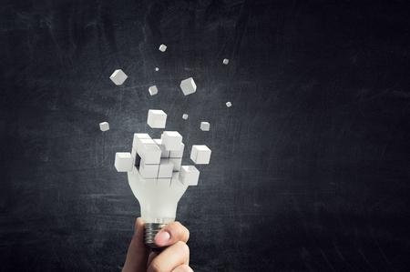 Ampoule pixélisée. Notion de développement. Technique mixte Banque d'images