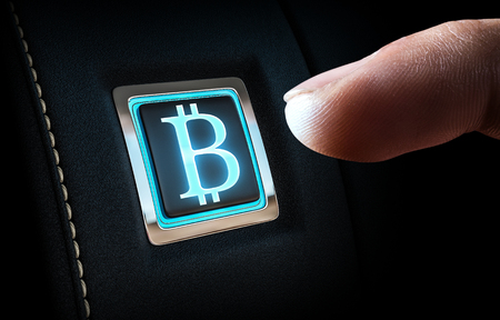 Close up of finger about to press Bitcoin button. Mixed media