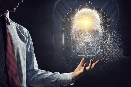 Silver digital head over businessman s hand