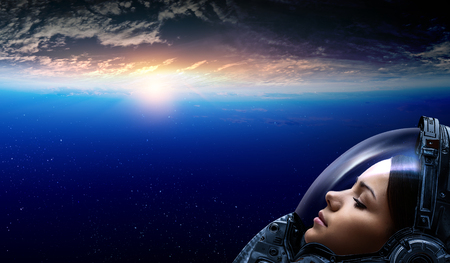 Female astronaut in space on planet orbit. Stock Photo