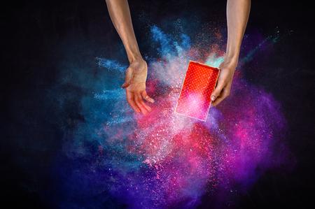 Man s hands holding a small magic paper box, mixed media