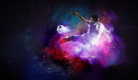 Soccer player in action. Mixed media 版權商用圖片 - 121614056