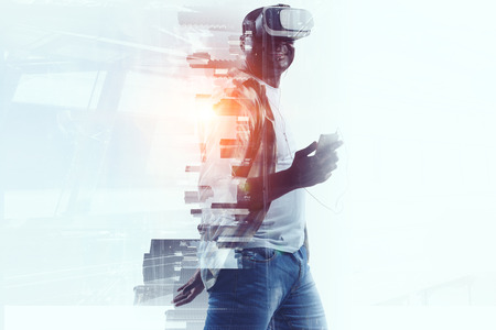 Virtual Reality headset on a black male. Mixed media Stock Photo
