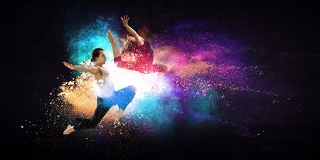Young modern ballet dancers in a jump. Mixed media Stock Photo