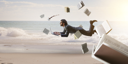 Joyful happe businessman levitating horizontally Imagens
