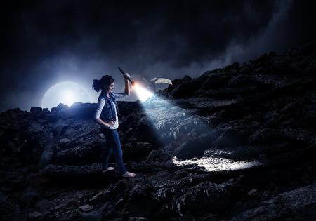 Young woman holding a flashlight 版權商用圖片