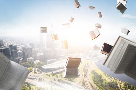 Books flying in the sky Stockfoto