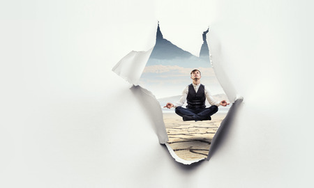 Torn paper hole effect with levitating businessman