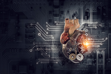 Anatomic heart model made with gears and mechanic parts, microcircuit background Stock Photo