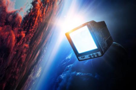 Vintage TV set levitating in space