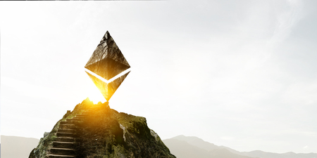 Ethereum symbol made of stone on a ladder 写真素材