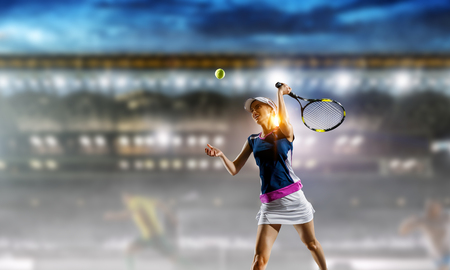 Young woman playing tennis in action. Mixed media 스톡 콘텐츠