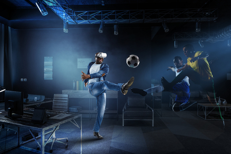 Virtual Reality headset on a black male playing soccer
