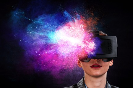 Young female in virtual reality. Mixed media Stock Photo