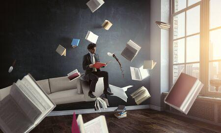 Young man reading a book. Mixed media
