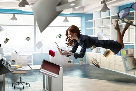 Joyful beautiful young levitating businesswoman. Mixed media Reklamní fotografie