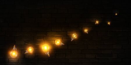 Classic light bulbs on black brick background