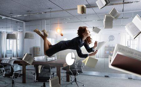Joyful beautiful young levitating businesswoman. Mixed media