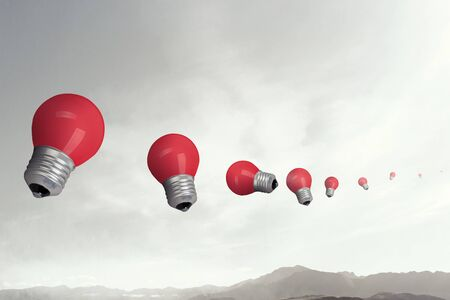 Classic light bulbs on landscape background Imagens