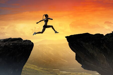 Jumping over precipice, challenge concept.