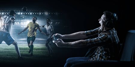 Young man playing football video game