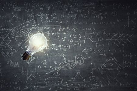 Light bulb on chalk board background